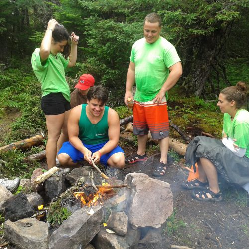Participants and City of St. John's staff cooking over open fire.