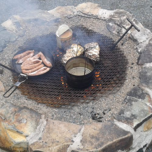 Food cooking over open fire.