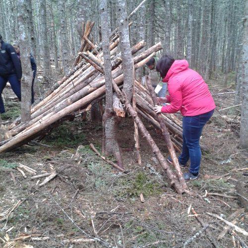 Participants building a hut.